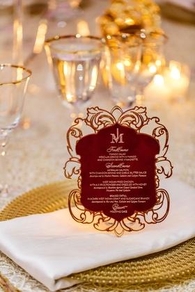 Gold charger plate white napkin burgundy menu card elegant details