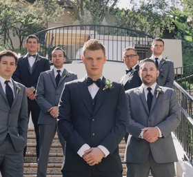 Backstreet Boys member with men in grey suits