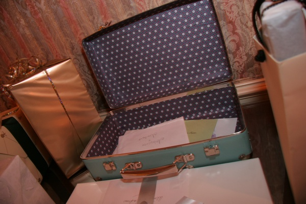 Wedding reception gift table with a vintage suitcase