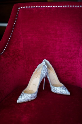 Red chair nailhead with sparkle shoes Christian Louboutin silver pointed toe pumps