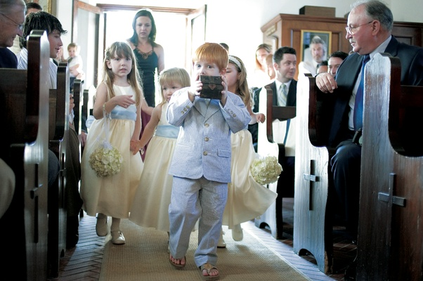 Young ring bearer wearing casual suit and flip flops