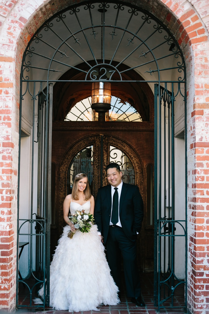 Bride in Monique Lhuillier wedding dress with Asian American groom