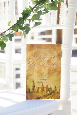 Antique-style ceremony booklet with photo of venue