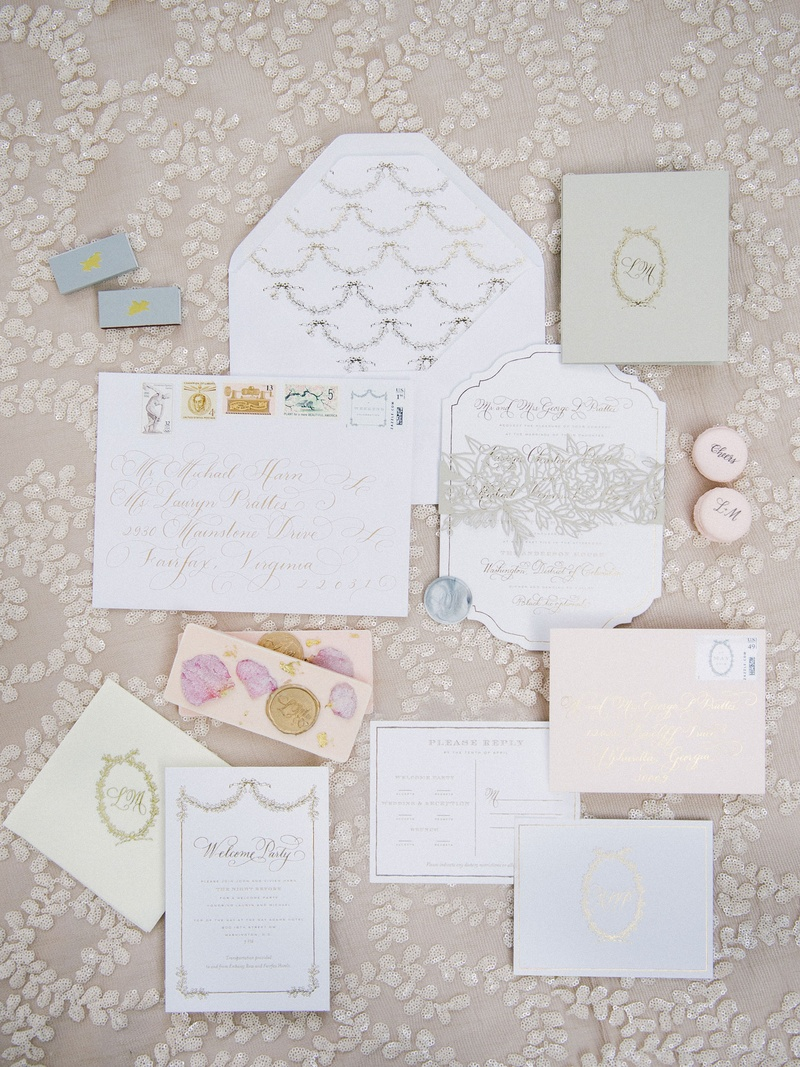 Parisian inspired wedding theme with soft dainty feminine invitations pastels and gold calligraphy