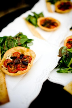 Wedding appetizer tomato and kalamata olive tart