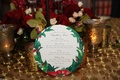 Wedding menu on circle paper with holly Christmas motif design