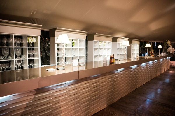 Bar with geometric design and glassware shelves