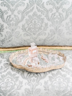 vintage bridal headpieces arranged on mirrored tray