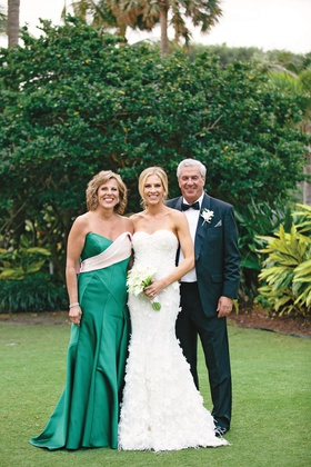 bride in marchesa wedding dress with parents, mother of the bride in green gown