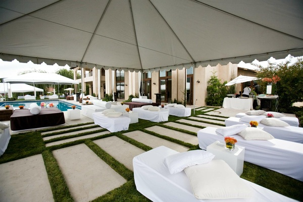 white couches and pathway under large tent