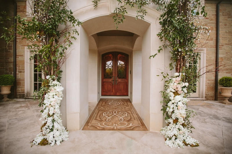 Entrance to family home embellished with greenery