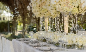 Tall white and ivory flower decorations with crystals hanging