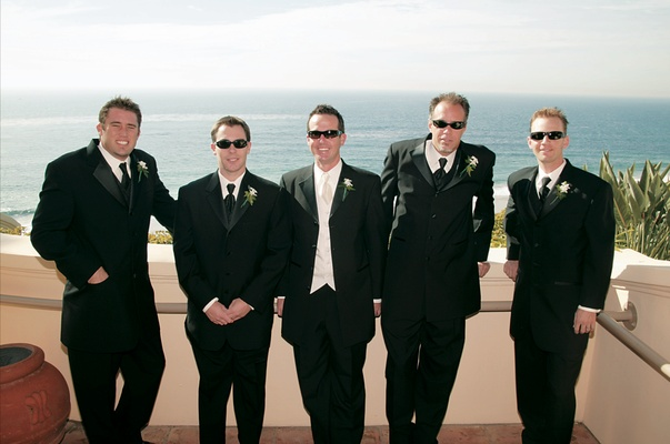 Oceanfront lack tuxedos with ebony and ivory ties