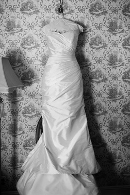 Black and white photo of a strapless Romona Keveza gown with ruching