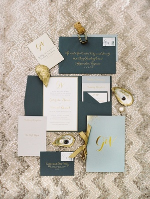 Navy blue grey envelope invitation with gold calligraphy light blue wedding program gold ribbon