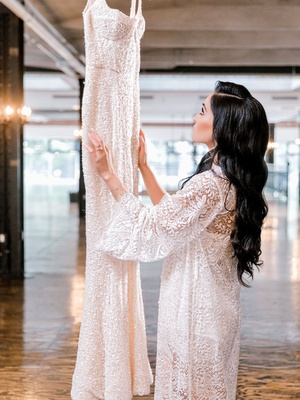 bride in textured sheer robe on wedding day getting ready to change into sparkling wedding dress