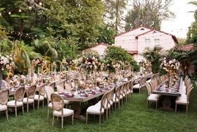 wedding reception hotel bel-air long wood tables fall inspired centerpiece flower arrangements