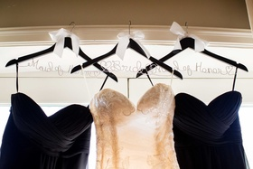 wood hangers maid of honor bride bows sweetheart neckline dresses black white hanging window wedding