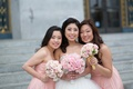 Bride with two bridesmaids in strapless pink J. Crew bridesmaid dresses