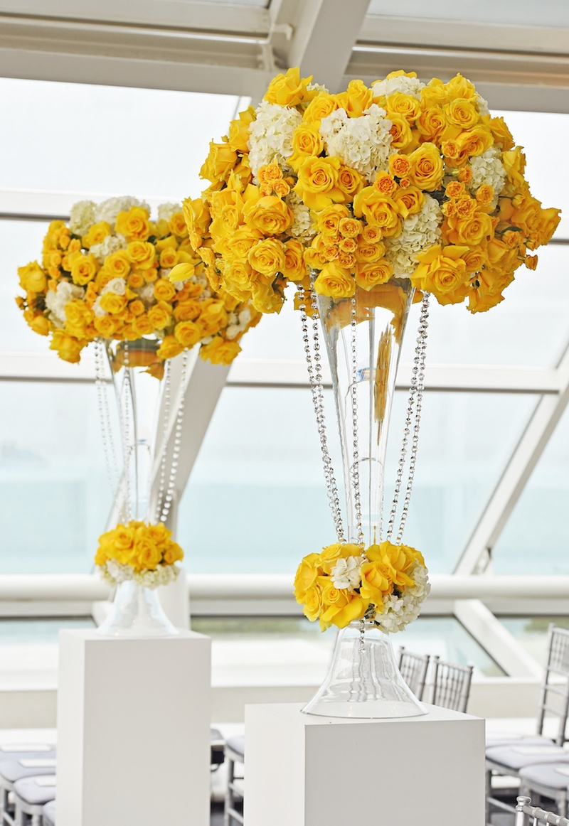 Wedding ceremony at the Adler Planetarium with yellow roses, tulips, and white hydrangeas in trumpet