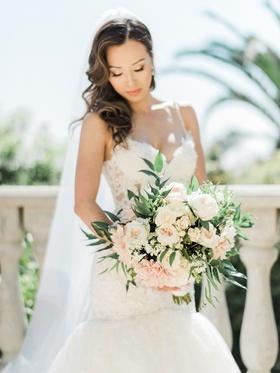 Bride with hair on one side lace dress bouquet white garden rose cafe au lait dahlia flowers soft