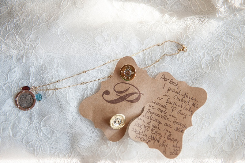 Bride's handwritten note to groom on die cut paper with unique gold cuff links