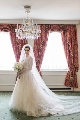 elegant bride detailed wedding gown ball gown long sleeves tulle full chapel length veil