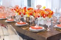 Wood table ghost chair faux fur yellow orange red poppy flower centerpiece rustic modern bridal