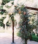 wedding ceremony decor outdoor jewish wedding wood arbor with organic greenery leaves asymmetrical