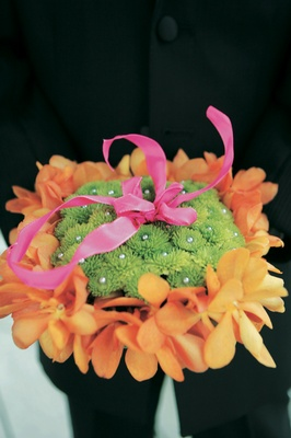 Ring bearer pillow made of green and orange flowers