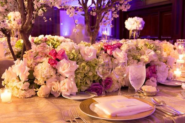 White rose, white hydrangea, green hydrangea, pink rose wedding reception table runner centerpiece