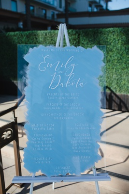 wedding ceremony sign white calligraphy acrylic lucite on easel blue brushstroke design