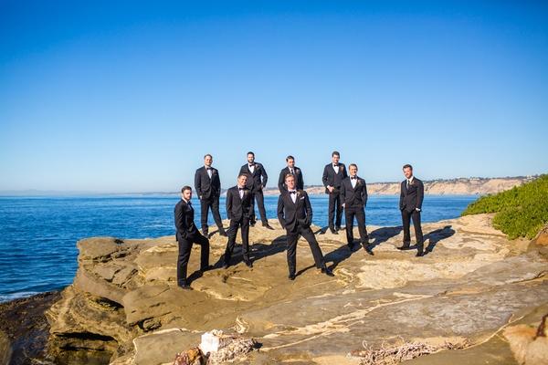 groom groomsmen posing seaside cliff la jolla california wedding classic looks handsome