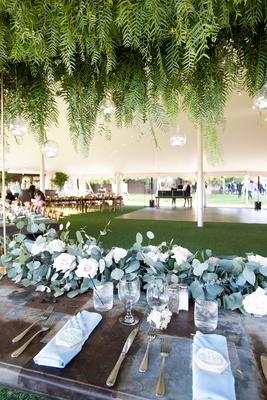 Echosmith singer Sydney Sierota and Cameron Quiseng wedding reception eucalyptus wood table ferns