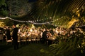 wedding reception hotel bel-air bistro string lights guests at luxury wedding dinner outside palms