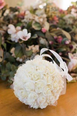 Flower girl pomander with white ribbon and roses