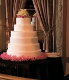 Round wedding cake with pink flower base