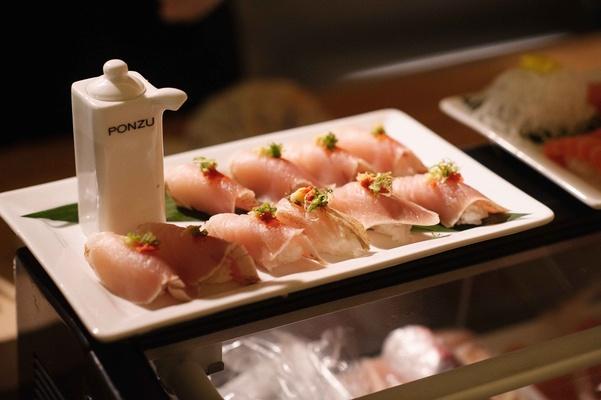 Ponzu soy sauce holder with sashimi sushi on white tray at Carol Leifer wedding reception
