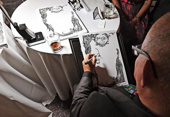 wedding reception alternative entertainment ideas caricature portrait artist drawing of guests