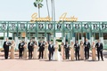 Wedding party bridesmaids in gold sequin dresses and groomsmen in suits at santa anita racetrack
