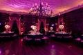 Mansion ballroom wedding reception with lavender lighting