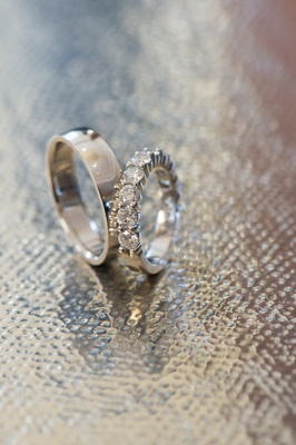 Bride's round-cut diamond band and men's band