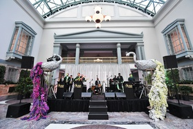 wedding band at chicago harold washington library silver peacock sculpture white pink purple flowers