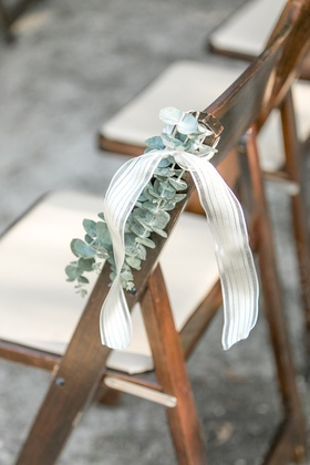 Wood ceremony chair wedding with eucalyptus greenery and ribbon chair