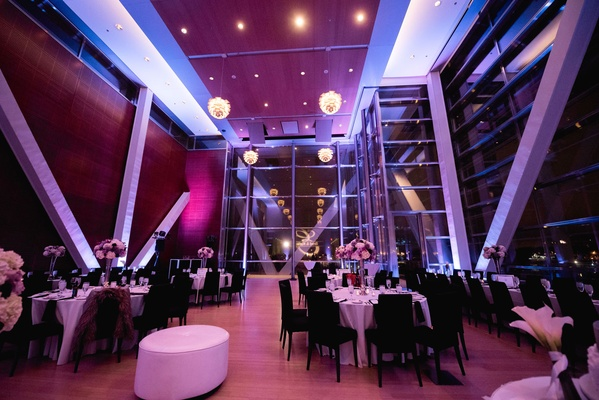 Wedding reception at Clinton Library in Arkansas with bright purple lighting design and fixtures