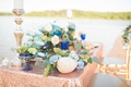 sequin tablescape with shells, candlesticks, floral arrangements