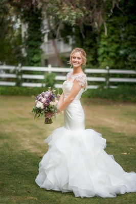 Bride wearing Hayley Paige wedding dress outside
