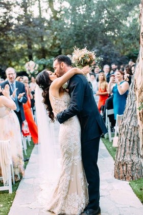 wedding ceremony outdoor bride groom kiss at end of aisle after ceremony