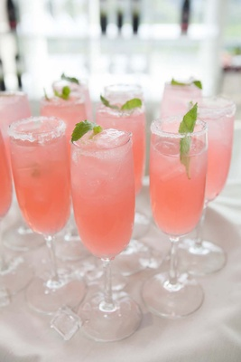 Pink cocktail with lemonade and fresh mint leaf