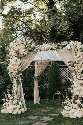 wedding ceremony structure chuppah champagne drapery white pink peach orange rose hydrangea flowers
